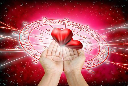 Hand on red background of astrology and love concept.