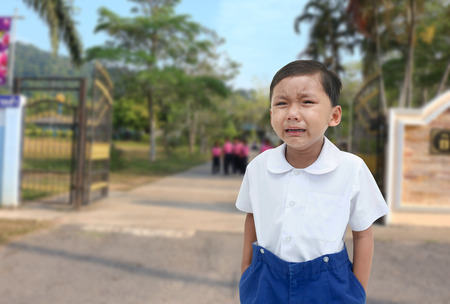 concern: Crying boy in school uniform
