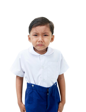 crazed: Crying boy in school uniform