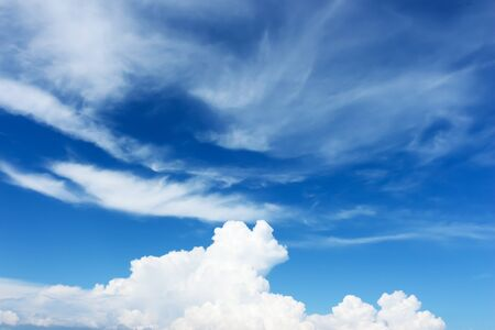 White clouds in the blue sky. Stock Photo