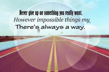 Inspirational quote on blurred road vintage style background. Zdjęcie Seryjne