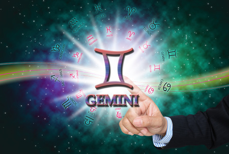 Astrologer mans touch to technology background of the horoscope ,with 12 zodiac.