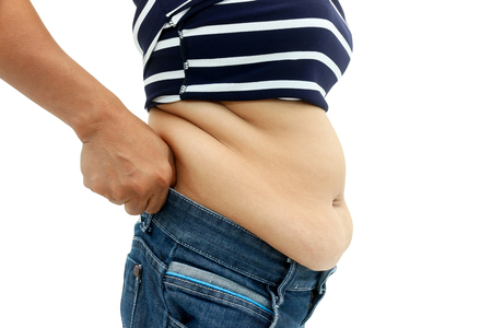 squeeze shape: abdominal surface of fat woman on white background.