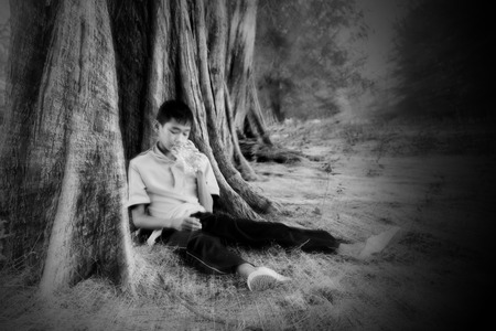 repentance: Blurred of teenage boy who has a drug in hand, he acting for teenage problem concept. Stock Photo