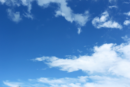 nebulosity: White clouds in the blue sky. Stock Photo