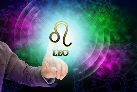 astrologer: Astrologer womans touch to technology background of the horoscope ,with 12 zodiac.