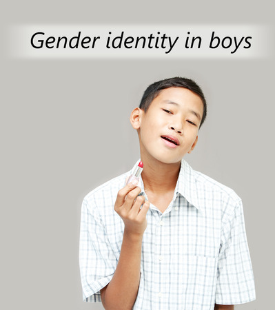 two faced: Asian teen boy is acting for the Gender Identity in boys,teen problem concept. Stock Photo