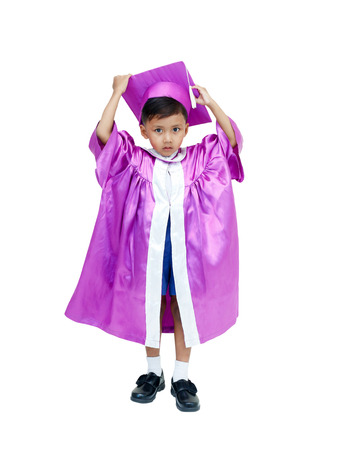 little asian boy in graduation gown .