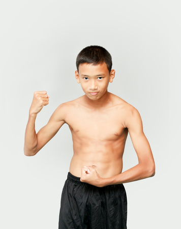 bodybuilding boy: Asian teenage boy who is bodybuilding his smile and happiness,good health concept. Stock Photo
