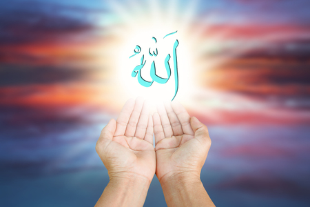 revelation: Hands of man praying to allah god of Islam on a sunset.The words spell is Allah means the God of Islam.