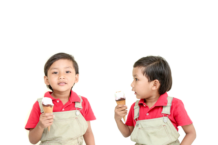 to seem: Twin little boy with ice cream ,he seem look like very happy.