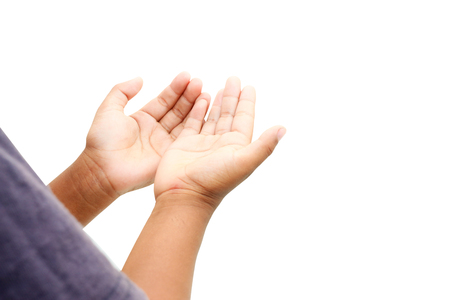 plead: Hand of child praying on white background with clipping path.