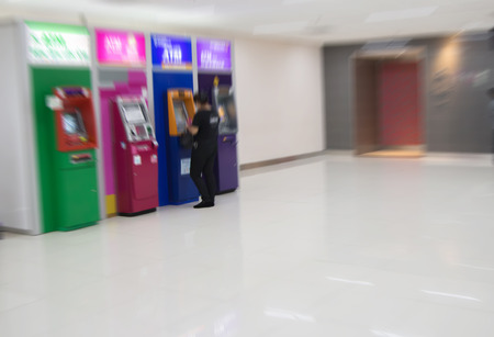pincode: Abstract Blurry people with automatic teller machine or ATM in shopping center