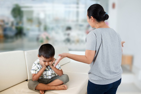 haggling:  Negative emotion parent reprove at child, family problem concept. Stock Photo