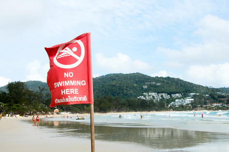 roaring sea: Warning no swimming sign on the beach at phuket Thailand,Thai Language is means can not swimming because it is very  danger.