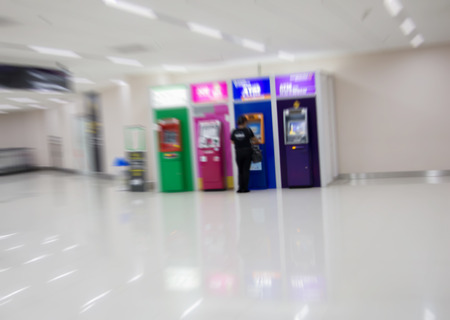 pincode: Abstract Blurry people with automatic teller machine or ATM in shopping center  Stock Photo
