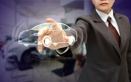 solicitude: business woman touch abstract car model for concept of car business. Stock Photo