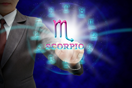 Astrologer womans touch to technology background of the horoscope ,with 12 zodiac.
