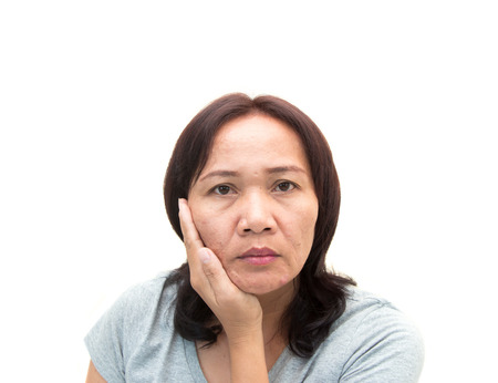 women middle aged worried with aging face .