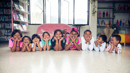 Satun Thailand,17-desember-2016; boys and girls  asian children in library and have smiley in face,Thailand land of smile can you see smiley in face everybody.vintage style filter.