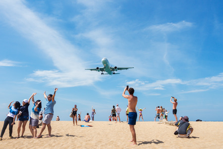 Phuket thailand,29-1-2017;Many people acting for take photo with the plane,The plane is landing to phuket international airport at mai khao beach phuket thailand. Editorial
