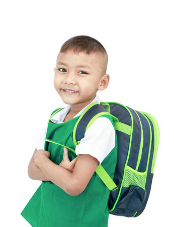 Boy elementary school student with backpack isolated on gray background with clipping path. 版權商用圖片