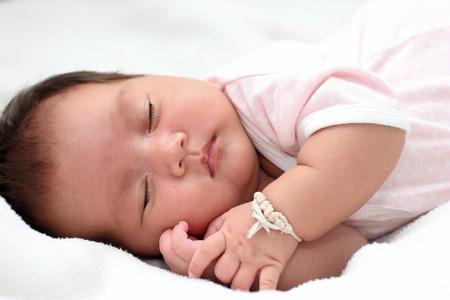Little girl sleeping on the bed. 版權商用圖片