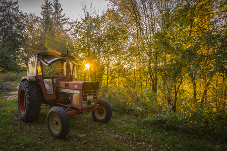 Abandoned old tractor sunset shot Stock fotó