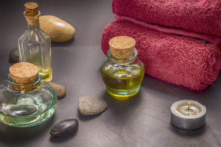 zen basalt stones and aroma oil on the stone background