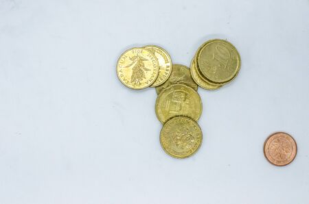 Different Euro cent coins in a pail. Stock Photo