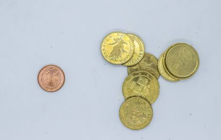 Different Euro cent coins in a pail