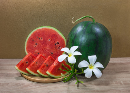 sliced watermelon on wooden table Stock Photo