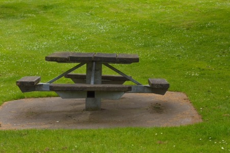 wooden picnic table on the grass