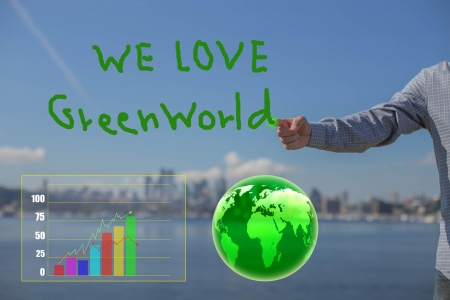 Business man hand write love green world photo