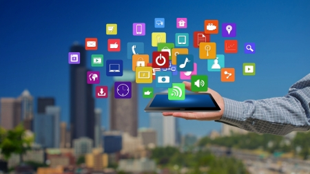 Tablet in hands with colorful icons,Creative Business  Stock Photo