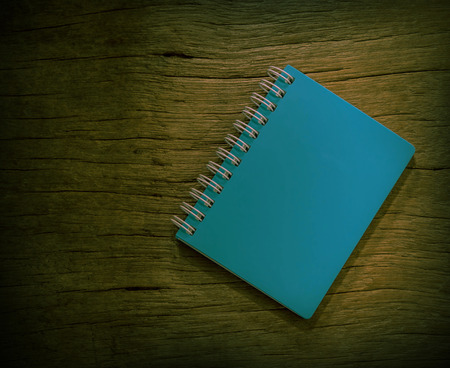 blue notebook with vintage background of  old wood. photo