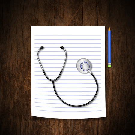 Stethoscope with pencil on wood background photo