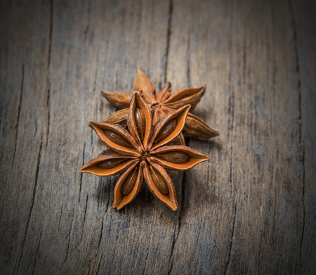aniseed: Anise stars heap on the wooden
