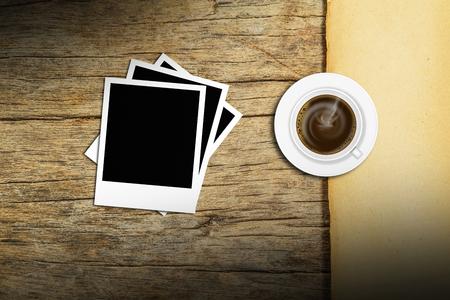 coffee with polaroid photo frame on wood background photo