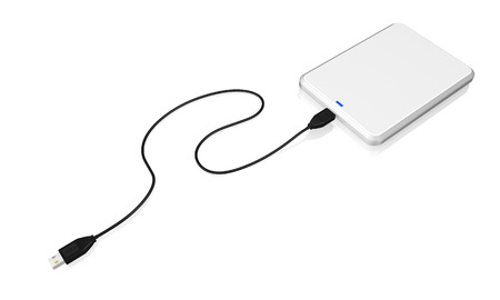 portable hard disk: Portable external hard disk drive with USB cable on white background