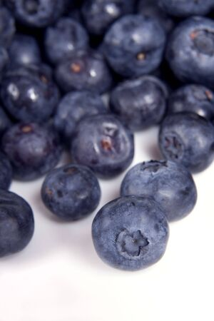 Vertical image of blueberries, shallow depth of field