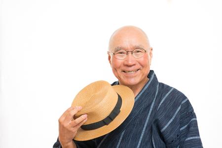 甚平に笑顔で日本シニア 写真素材