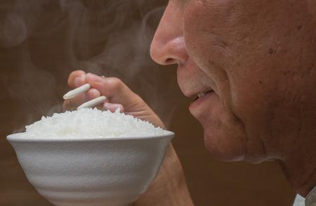日本人は、ご飯を食べる 写真素材