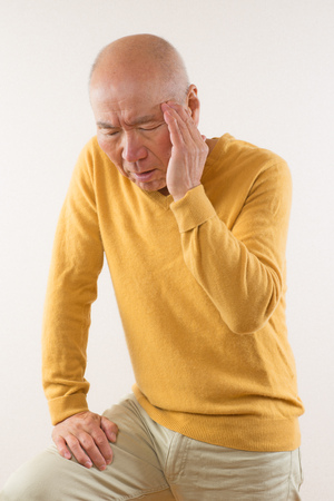 wincing: Japanese wincing in pain in seniors Stock Photo