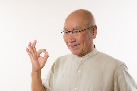 Senior Japanese okay sign Stock Photo