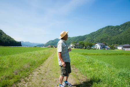Japanese walk to the rural water supply and senior Stock Photo