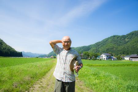 Los japoneses caminan hacia el suministro de agua rural y Foto de archivo