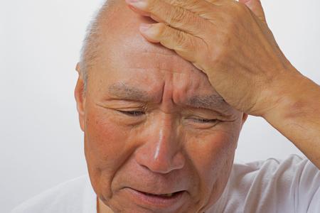 Senior mens troubled face
