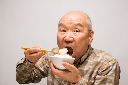 Japanese people eat rice SR. Stock fotó