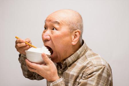 Japanese people eat rice SR. Reklamní fotografie